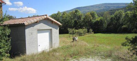 Terrain constructible + garage – T1341